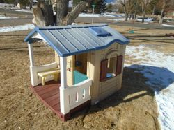 Step 2 Naturally Playful Front Porch Playhouse - $170
