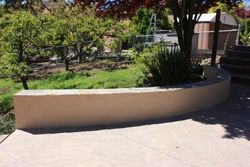Stucco wall with slate cap