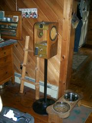 antique 5 cents, peanut vending machine, victor vending with cast iron stand