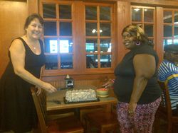 Jean and Danielle cutting cake