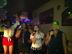 The birthday girl Victoria (far left) celebrating with the ladies at 502 Bar Lounge's Social Saturday Night Karaoke.