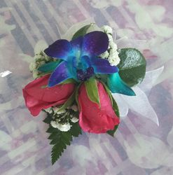 Pink and blue Singapore Orchid corsage