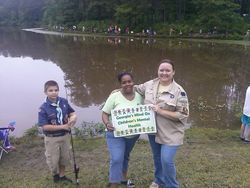 Boys scouts & Melissa Alford at the fishing derby