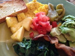 Scrambled Eggs with Natural Bacon, Almond Flour Toast, Roasted Bell Peppers, Spinach, Tomato, Avocado and Pineapple