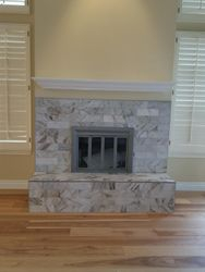 Finished - new tile and mantle
