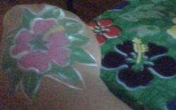 flower on tablecloth and flower I painted on me