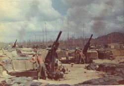 105mm Howitzers in a fire-base.