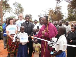 Bishop Mdegella about to cut the ribbon to dedicate the Pommern Water Project