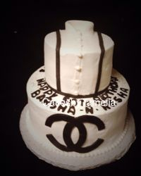 A black and white shirt and chanel cake