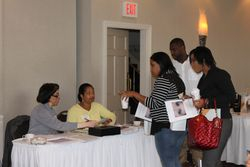 A family registers with Our Treasurer-Shirley and Our Executive Secretary-Angela