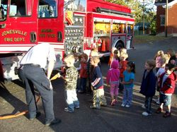 Asst Chief Hearn teaching children fire saftey
