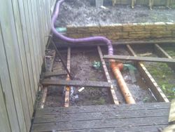 Old drainage and decking to be removed.