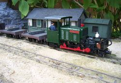 'Moelwyn'  from the Ffestiniog railway stands beside the new High Westland passenger station buildings while waiting for the road.