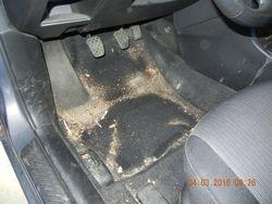 Drivers side underneath floor matt