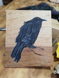 Hand painted Raven on hardwood.