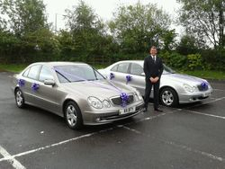 Jeff with two cars in purple livery