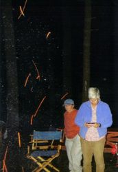 Karen and friend watch as sparks