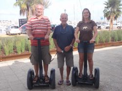 Us on the Segways with a very short looking Ron!