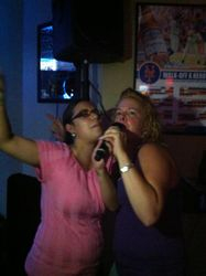 Chrissy and Andrea performing for the crowd at Legendary Friday Night Karaoke!