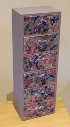 Mini decoupaged and painted drawers.