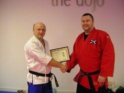 Presentation to Sensei Karl T Grubis of Membership in the Scottish Fighting Arts Society