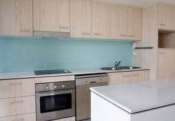 Coloured glass splashbacks are suitable for all styles of kitchens and bathrooms.