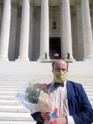 Alec Frazier Holding Bouquet of Flowers in Front of Casket Guarded by Clerks at West Façade of US Supreme Court Building from West During Lying in Repose of Associate Supreme Court Justice Ruth Bader Ginsburg