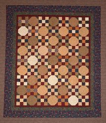 "2015 Raffle Quilt - ""Snowballs and Patches"""