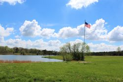 The Flagpole by the Bellamy Lake