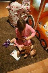 Dressing up their new teddy bear