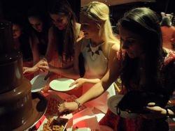 Girls loving the chocolate fountain in leeds