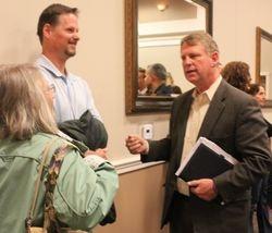 Allan Kittleman speaks to two residents