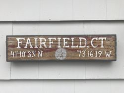 Small Fairfield, Ct sign on natural wood