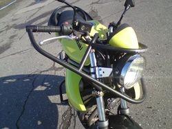 Motokursu motocikla prieksejas dalas aizsargs