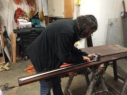 Stephanie measuring wood
