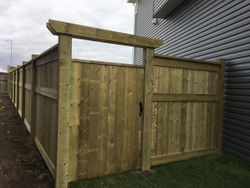 green pressure treated fence f2