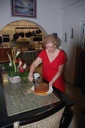 Mary Ann cuts the rum cake!