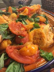 Tagine garnished with fresh basil