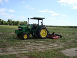Tractor with mower attached