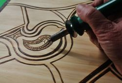 The Songbird Tray being Wood-burned