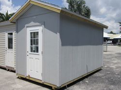 8x14 with Hardie Panel ( board ) and home door