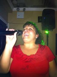 Irka gracing the crowd with her style at Legendary Friday Night Karaoke!