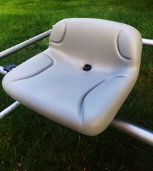 Tractor style seat with drain hole