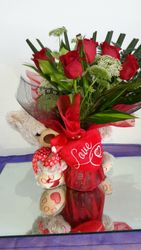 Large teddy with roses with black and red mesh
