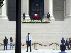 View of Casket Guarded by Clerks and Crowd of Mourners at West Façade of US Supreme Court Building from West During Lying in Repose of Associate Supreme Court Justice Ruth Bader Ginsburg