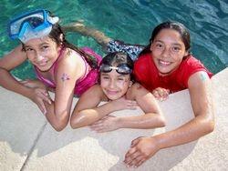 Girls Having Fun in the Sun with their Glitter Body Art