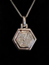 Hexagon pendant with 6 trillion-cut diamonds