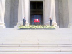 Close-Up View of Casket Guarded by Clerks at West Façade of US Supreme Court Building from West During Lying in Repose of Associate Supreme Court Justice Ruth Bader Ginsburg