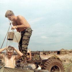 Leroy Gavigan giving Earl Fant a shower
