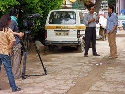 Filming with the head of CHETNA, Sanjay Gupta